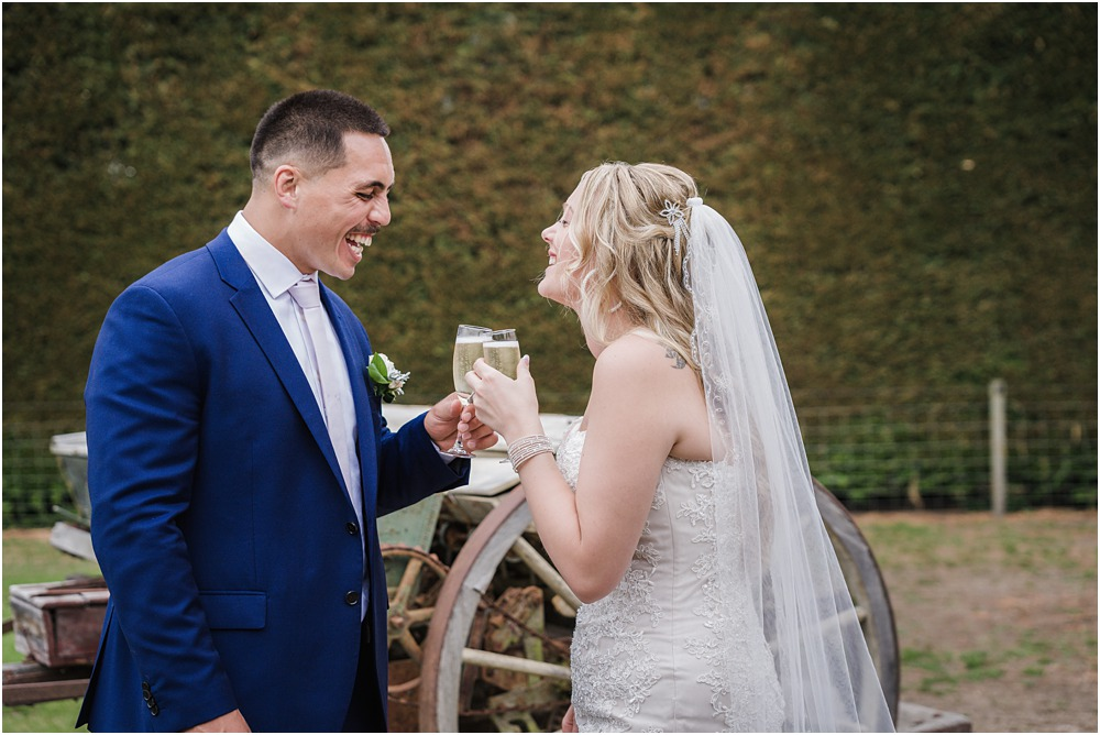 bride and groom toasting at their wedding at lacebark venue