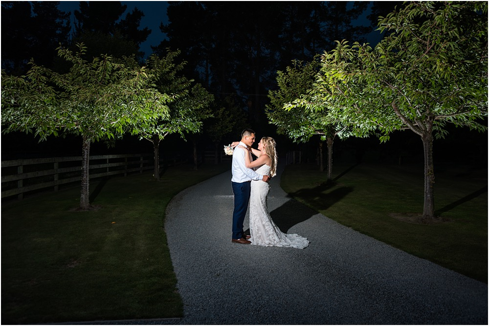 night photos of bride and groom hugging on the driveway at lacebark wedding venue