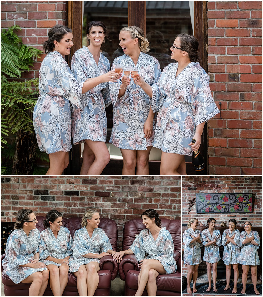 bride and bridesmaids in robe laughing and drinking wine