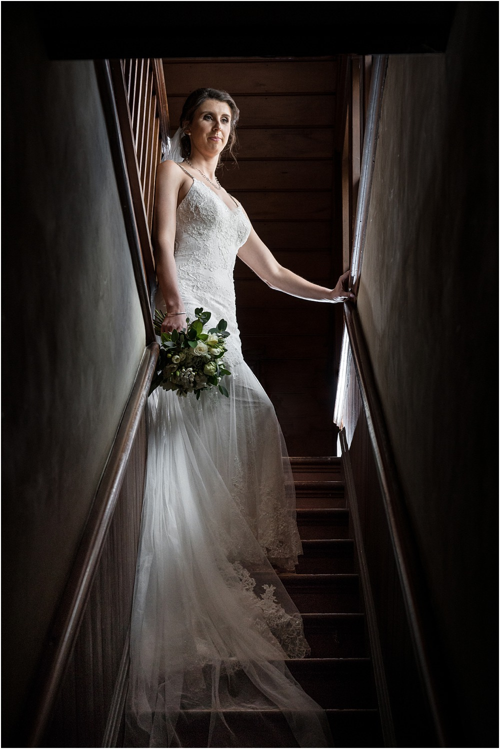 high contrast image of bride standing on the artic stairs