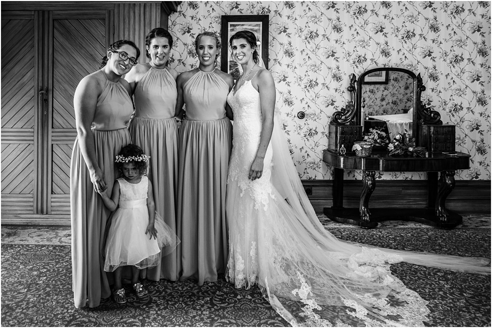 black and white portrait of bride, bridesmaids and flower girl