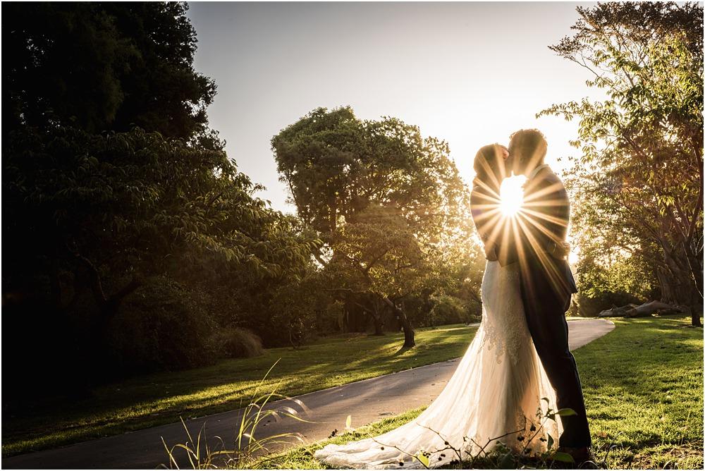 Christchurch Photographer - star burst sunset photo of bride and groom at riccarton house wedding venue
