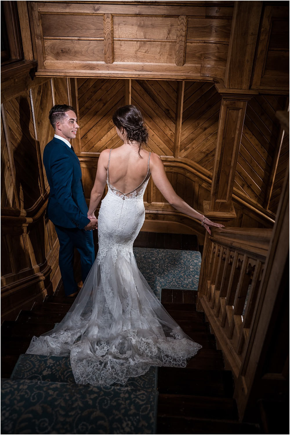 Christchurch Photographer - dramatic photo of bride and groom standing on the stairs at riccarton house wedding