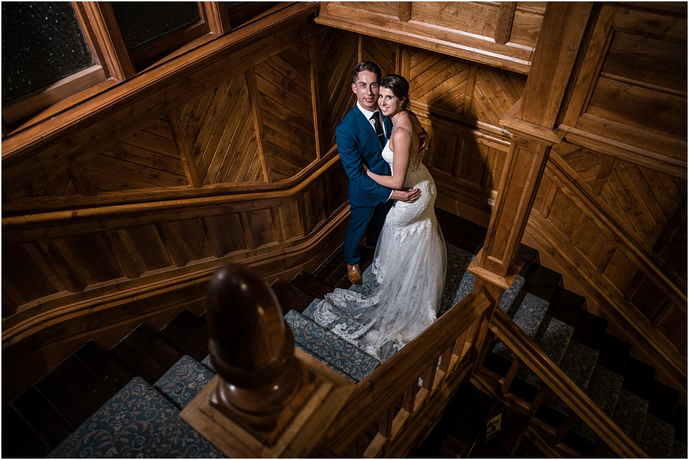 bride and groom stuggling on stairs at riccarton house wedding venue