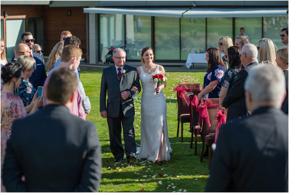 bride and dad walking up the isle duding a wedding at Braemar Lodge