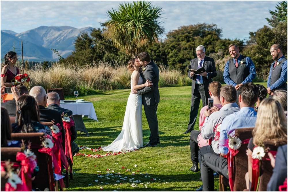 Braemar Lodge wedding photo of bride and groom kissing at the top of the isle during the ceremony