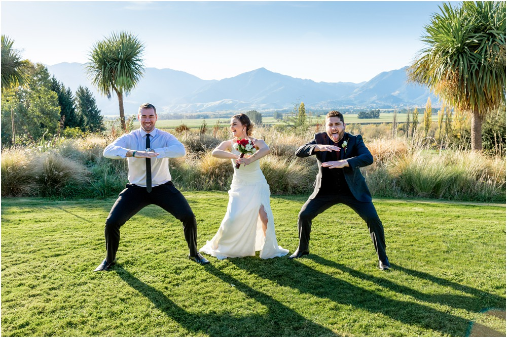 bride-groom and friend doo a haka after the wedding at Braemar Lodge