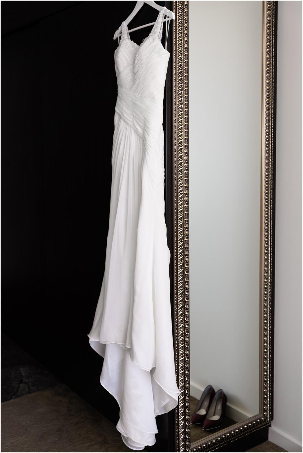 bride's dress hanging next to mirror at braemar lodge