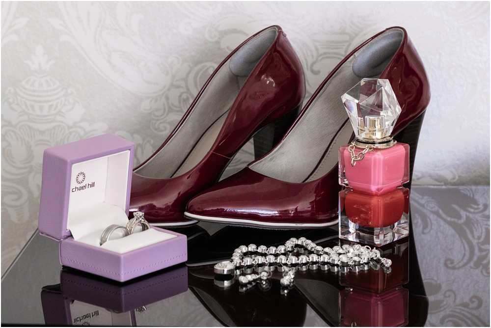 bride's shoes-jewellery-perfume on table at Braemar