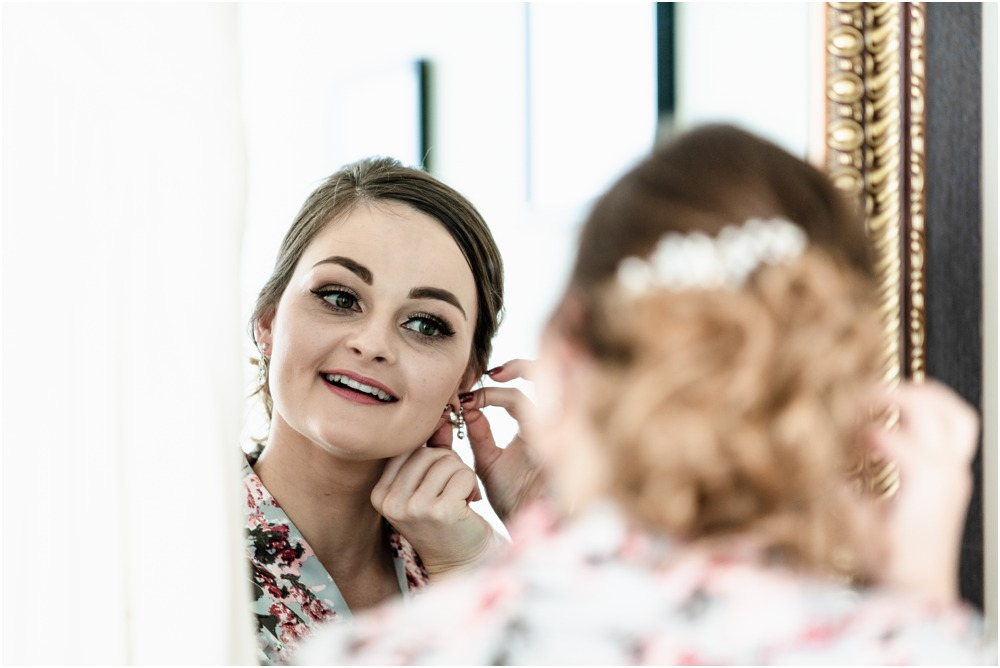 bride looking in the mirror at Braemar Lodge