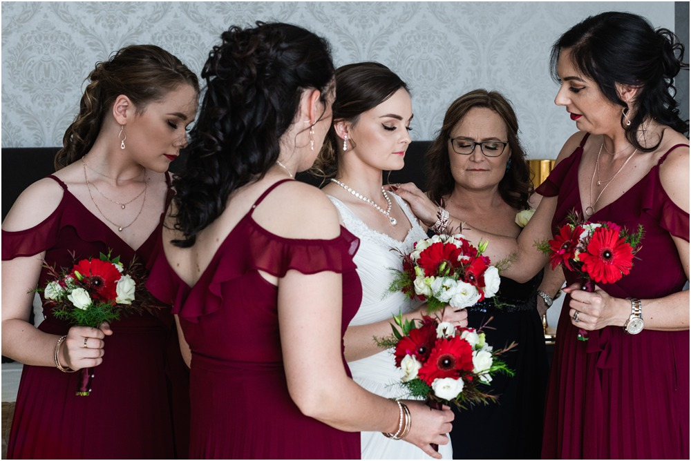 bride and bridesmaids having a prayer before they wedding ceremony at Braemar Lodge