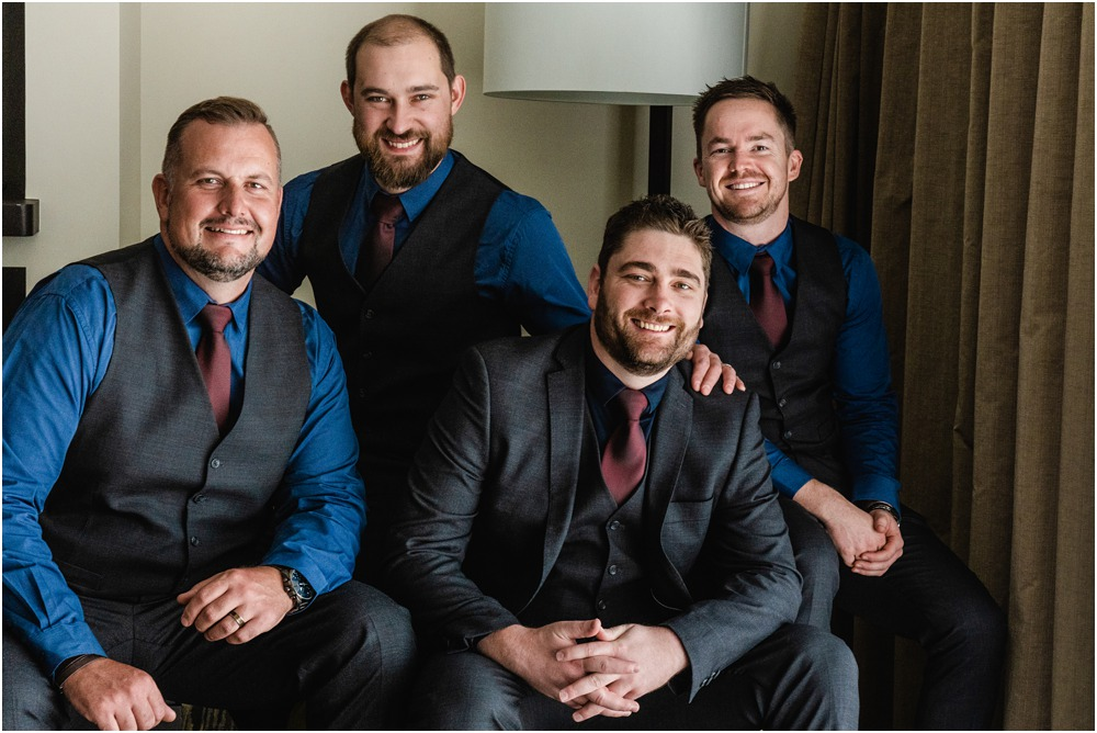 groom and groomsmen posing for a photo before the wedding at Braemar Lodge