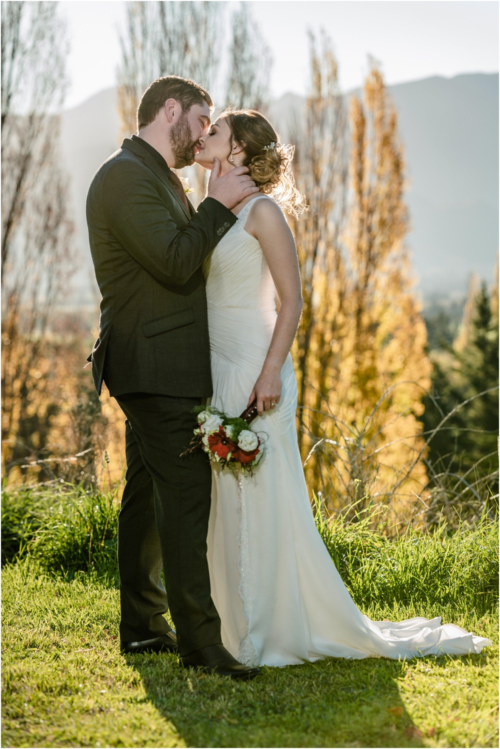 Braemar Lodge Wedding Photo of bride and groom kissing romantically