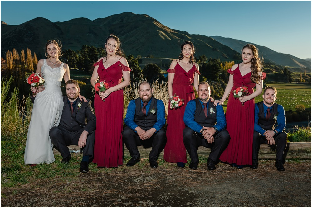 Bridal party pose for a photo during sunset at Braemar Lodge Hanmer Springs