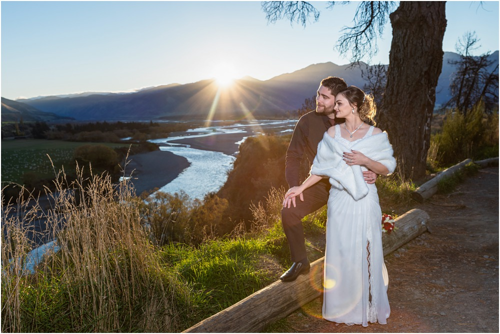 Bride and groom pose for a photo during sunset at Braemar Lodge Hanmer Springs