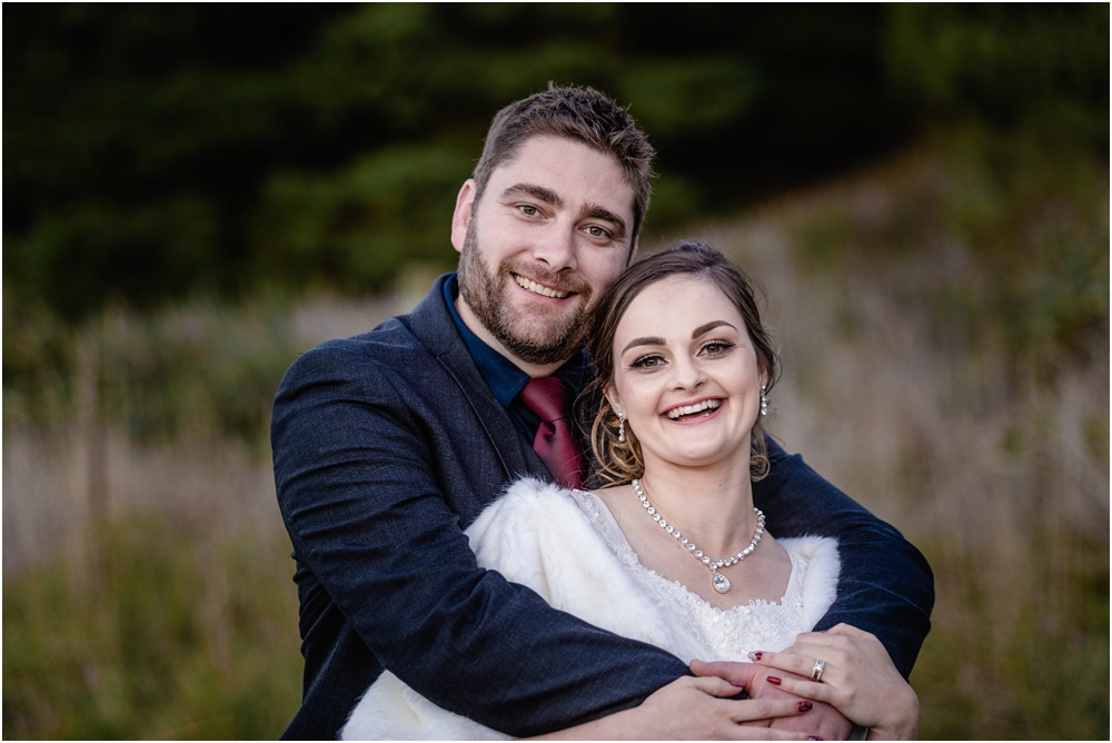 Bride and groom hugging during a photo wedding portrait session at Braemar Lodge