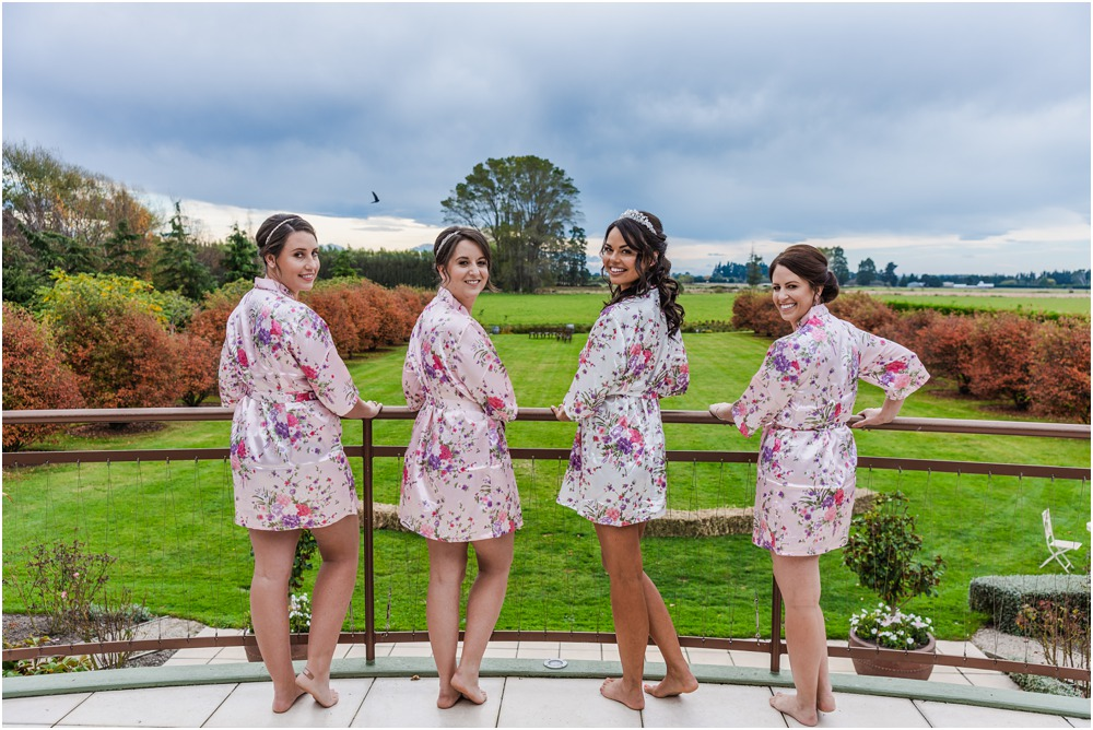 Harpers Homestead Wedding-bride with bridesmaids in dressing gowns on the balcony