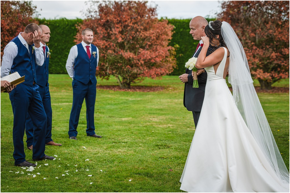 Bride and groom in tears when bride walks to top of isle at Harpers Homestead Wedding