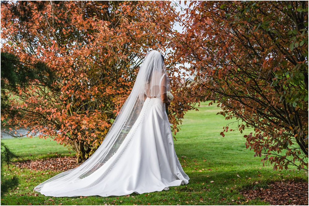 bride walking through trees in Autumn at Harpers Homestead